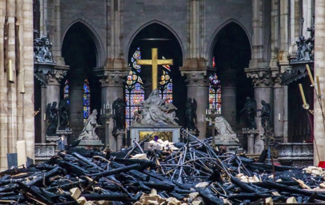 the latest macron wants notre dame rebuilt within 5 years