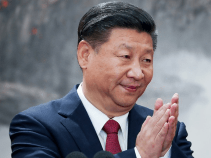 Chinese President Xi Jinping speaks at the podium during the unveiling of the Communist Party's new Politburo Standing Committee at the Great Hall of the People on October 25, 2017 in Beijing, China. China's ruling Communist Party today revealed the new Politburo Standing Committee after its 19th congress. (Photo by …