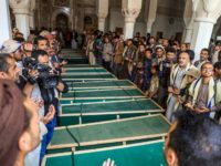 Yemeni mourners pray slogans by coffins at a mosque during a funeral in the Huthi-rebel-held capital Sanaa on March 14, 2019, for civilians killed in strikes in the northern Hajjah province. - The United Nations had confirmed that 22 civilians, including 12 children, were killed in strikes on March 9 …