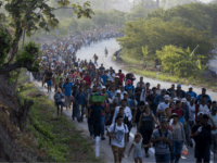 FILE - In this April 20, 2019, file photo, Central American migrants, part of a caravan hoping to reach the U.S. border, move on the road in Escuintla, Chiapas state, Mexico. The number of migrants apprehended at the Southern border topped 100,000 for the second month in a row, as …