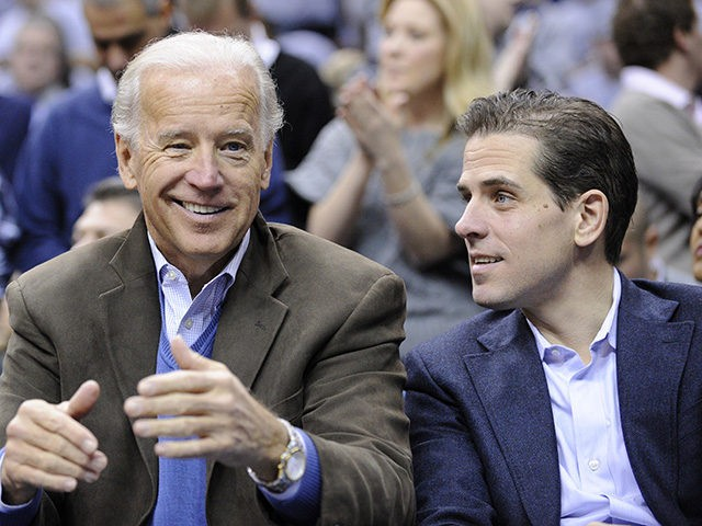 Vice President Joe Biden, left, with his son Hunter, right, at the Duke Georgetown NCAA college basketball game, Saturday, Jan. 30, 2010, in Washington. (AP Photo/Nick Wass)