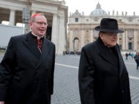 Cardinal Willem Jacobus Eijk, left, of the Netherlands, and US Cardinal Raymond Leo Burke leave at the end of a meeting, at the Vatican, Tuesday, March 5, 2013. The Sistine Chapel closed to visitors on Tuesday and construction work got under way to prepare it for the conclave, but five …