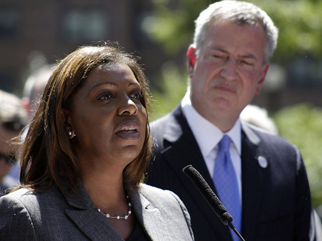 New York City Public Advocate Letitia James, left, speaks during a press conference, Thursday, Aug. 28, 2014, in Brooklyn as New York City Mayor Bill de Blasio watches from behind. De Blasio discussed preparations for the opening of the city's universal pre-kindergarten program one day after Comptroller Scott Stringer said …