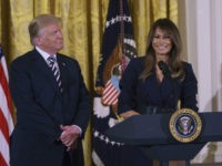 President Donald Trump looks to first lady Melania Trump as she speaks in the East Room of the White House in Washington, Wednesday, May 9, 2018, during an event celebrating military mothers and spouses. (AP Photo/Carolyn Kaster)