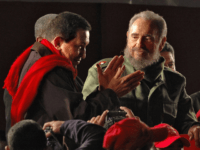 Cuban President Fidel Castro (R) looks at his Venezuelan counterpart Hugo Chavez who claps his hands at the closing ceremony of the Alternative People' s Summit in Cordoba, Argentina, 21 July 2006. The Presidents were in Argentina to participate of the XXX Mercosur Summit. AFP PHOTO/Pablo PORCIUNCULA / AFP / …