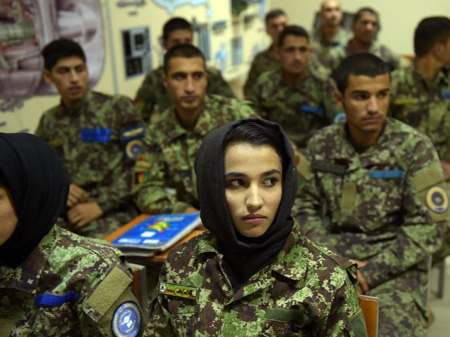In this photograph taken on September 29, 2016, new Afghan air force pilots attend a class at the air force university in Kabul. Under pressure from the Taliban, Afghanistan's military is increasingly relying on the country's young air force, and, together with Western allies, is speeding up its training of …