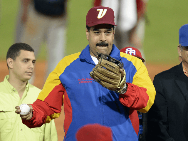 Venezuelan President Nicolas Maduro attends the opening ceremony of the 2014 Caribbean baseball series, on February 1, 2014, in Porlamar city, Nueva Esparta state, Margarita Island, Venezuela . AFP PHOTO/LEO RAMIREZ / AFP PHOTO / Leo RAMIREZ (Photo credit should read LEO RAMIREZ/AFP/Getty Images)