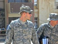 In this Sunday, Sept. 21, 2008, file photo, 1st Lt. Michael C. Behenna, left, and his defense attorney Capt. Tom Clark, right, walk in Camp Speicher, a large U.S. base near Tikrit, north of Baghdad, Iraq. The White House announced Monday, May 6, 2019, that President Donald Trump pardoned Behenna, …