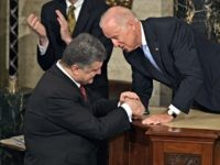 "US Vice President Joe Biden (R) speaks with Ukrainian President Petro Poroshenko before he addresses a joint meeting of Congress at the US Capitol in Washington, DC, September 18, 2014. Poroshenko pleaded with Washington Thursday to provide his country with ""special,"" non-NATO security status to help beef up its defenses …"