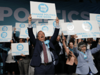 Brexit Party leader Nigel Farage (C) holds up a placard at the end of a European Parliament election campaign rally at Olympia London, west London on May 21, 2019. (Photo by Tolga AKMEN / AFP) (Photo credit should read TOLGA AKMEN/AFP/Getty Images)