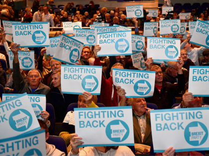 Supporters of The Brexit Party hold placards as they wait for the start of the first public rally of their European Parliament election campaign in Birmingham, central England on April 13, 2019. (Photo by Daniel LEAL-OLIVAS / AFP) (Photo credit should read DANIEL LEAL-OLIVAS/AFP/Getty Images)