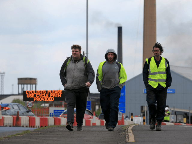 Workers leave from British Steel's Scunthorpe plant in north Lincolnshire, north east England on May 22, 2019. - British Steel collapsed on Wednesday after the government said last-ditch talks with its owners failed to secure a financial rescue. The High Court in London ordered British Steel Limited into compulsory liquidation, …