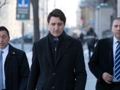 "Canadian Prime Minister Justin Trudeau walks to a press conference from the Prime Minister's office in Ottawa, Ontario, on March 7, 2019. - Trudeau on Thursday denied allegations of ""partisan"" political meddling in the criminal prosecution of corporate giant SNC-Lavalin, that have plunged his Liberal government into its worst crisis …"