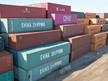 China Shipping Company and other containers are stacked at the Virginia International's terminal in Portsmouth, Va., Friday, May 10, 2019. President Donald Trump's latest tariff hike on Chinese goods took effect Friday and Beijing said it would retaliate, escalating a battle over China's technology ambitions and other trade tensions. (AP …