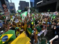 Supporters of Brazilian President Jair Bolsonaro demonstrate along Paulista Avenue in Sao Paulo on May 26, 2019 to shore up the ultraconservative government as it faces growing opposition, while marches are planned across Brazil. - Bolsonaro, who took power in January on a promise to revive Latin America's biggest economy, …