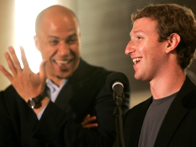 Newark Mayor Cory Booker, left, laughs as Mark Zuckerberg, right, founder and CEO of Facebook, talks about his donation of $100 million to help Newark public schools during a press conference at the Robert Treat Hotel in Newark, N.J., Saturday, Sept. 25, 2010. Also there is N.J. Gov. Chris Christie, …