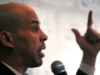 Democratic presidential candidate Sen. Cory Booker, D-N.J., gestures as he addresses guests at a house party during a campaign stop in Claremont, N.H., Friday, March 15, 2019. (AP Photo/Charles Krupa)