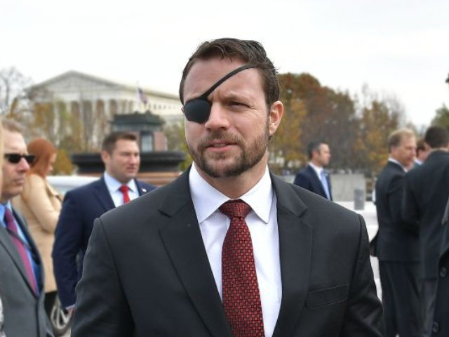 Republican House member-elect Dan Crenshaw is seen after posing for the 116th Congress members-elect group photo on the East Front Plaza of the US Capitol in Washington, DC on November 14, 2018. (Photo by MANDEL NGAN / AFP) (Photo credit should read MANDEL NGAN/AFP/Getty Images)