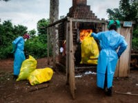 Health workers burn medical waste generated during care of patients with Ebola virus, on August 21, 2018 in Mangina, near Beni, in the North Kivu province. - Sixty-one people have died in the latest outbreak of Ebola in the Democratic Republic of Congo (DRC), the authorities said, adding that four …
