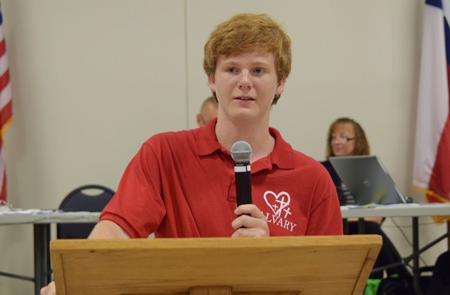 Calvary Christian Academy student James Holcomb speaks to the San Jacinto County Commissioners Court about religious symbols on county buildings. (Photo: Breitbart News/Lana Shadwick)