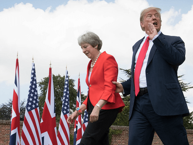 AYLESBURY, ENGLAND - JULY 13: Prime Minister Theresa May and U.S. President Donald Trump make their way to a joint press conference following their meeting at Chequers on July 13, 2018 in Aylesbury, England. US President, Donald Trump held bi-lateral talks with British Prime Minister, Theresa May at her grace-and-favour …