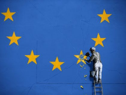 E.U. A recently painted mural by British graffiti artist Banksy, depicting a workman chipping away at one of the stars on a European Union (EU) themed flag, is pictured in Dover, south east England on May 8, 2017. (Photo by Daniel LEAL-OLIVAS / AFP) / RESTRICTED TO EDITORIAL USE - …