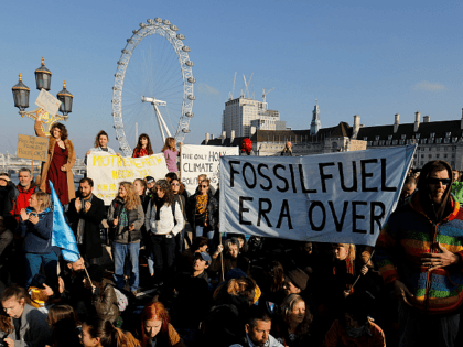 Demonstrators take part in a pro-environment protest as they block Westminster Bridge in central London on November 17, 2018, to show anger at what they see as government inaction on climate and ecological issues. - Organized by Extinction Rebellion, the protest is part of many taking place this weekend to …