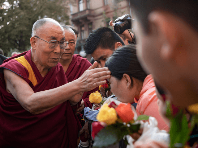 "ibetan spiritual leader the Dalai Lama (L) greets wellwishers as he arrives on September 20, 2018 in Heidelberg, western Germany. - The Dalai Lama is attending the International Science Festival where he is to give a speech on ""Happiness and Responsibility"". (Photo by Marijan Murat / dpa / AFP) / …"