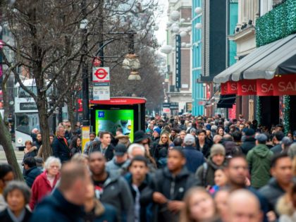 Crowds of shoppers take to Oxford Street in central London on December 26, 2018, as Boxing Day sales take place all over the country. - Troubled UK high-street retailers shed almost 150,000 jobs this year, hit by high business property taxation, flagging growth and rising online sales, a study showed …