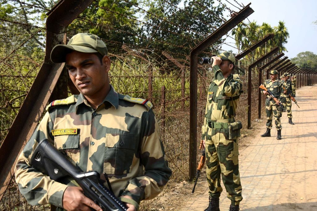 Indian Border Security Force (BSF) personnel keep a vigil watch near India-Bangladesh fencing border during a patrol ahead of India's 70th Republic Day celebration at Lankamura village, on the outskirts of Agartala, the capital of northeastern state of Tripura on January 24, 2019. - 31 stranded Rohingya refugees were detained on January 22 in Tripura, where members of the stateless group had been stuck in no-mans land on the India-Bangladesh border. (Photo by Arindam DEY / AFP) (Photo credit should read ARINDAM DEY/AFP/Getty Images)