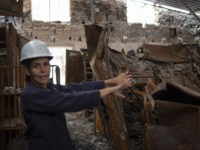 A worker talks to journalists during their first visit to Brazil's National Museum since the building burnt down last September, in Rio de Janeiro, Brazil, on February 12, 2019. - Brazil's historic National Museum was gutted by fire last year. The 200-year-old institution was considered the main natural history museum …