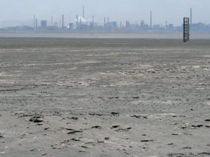 A vast expanse of toxic waste fills the tailings dam on April 21, 2011, frequently whipped up by strong winds dumping mllions of tonnes of radioactive materials toward surounding villages where farmers blame the state-owned giant Baogang Group, China's largest producer of rare earth.