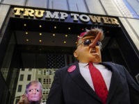 NEW YORK, NY - APRIL 1: Protestors wearing Donald Trump masks rally outside of Trump Tower during an April Fools' Day protest against U.S. President Donald Trump, April 1, 2019 in New York City. (Photo by Drew Angerer/Getty Images)