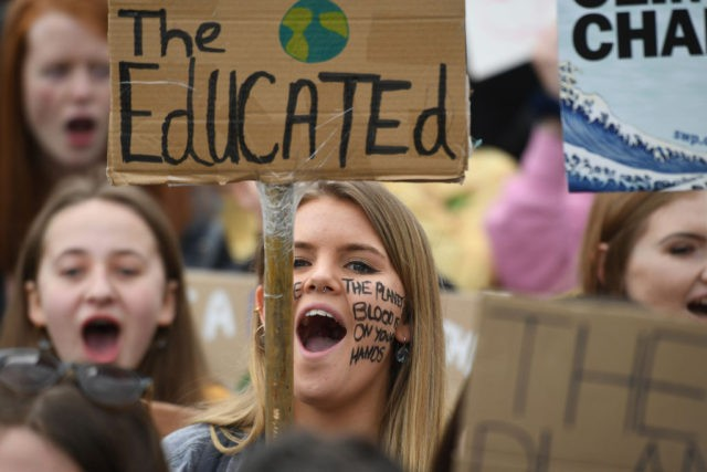 Supporters carry placards as they march during the YouthStrike4Climate demonstration in central London on April 12, 2019. (Photo by Daniel LEAL-OLIVAS / AFP) (Photo credit should read DANIEL LEAL-OLIVAS/AFP/Getty Images)
