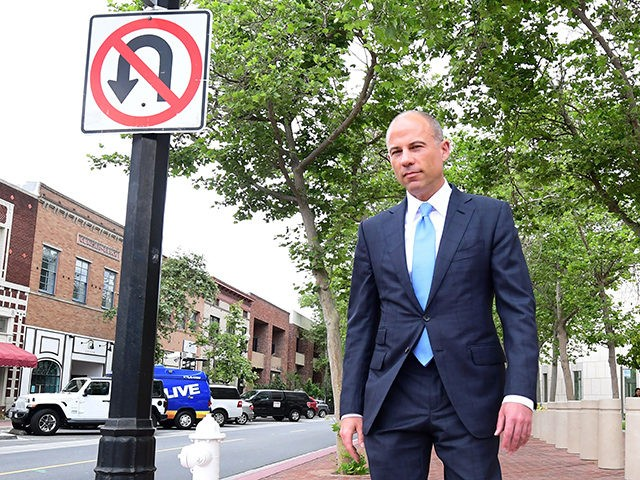 Attorney Michael Avenatti makes his way to an awaiting vehicle after addressing the media outside the Santa Ana federal courthouse in Santa Ana, California on May 7, 2019. - A federal judge gave him until May 15 to either find a new attorney for representation, decide if he needs a …