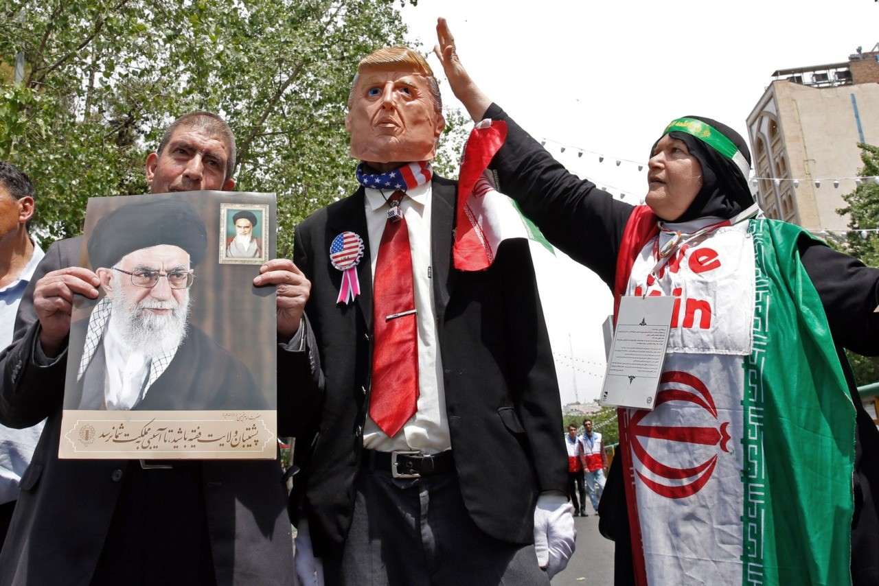 "Iranian demonstrators carry a portrait of Iran's Supreme Leader Ayatollah Ali Khamenei and an effigy of US President Donald Trump during a rally in the capital Tehran, on May 10 2019. - Iranian foreign minister blamed the EU for the decline of Tehran's nuclear accord with world powers and insisted the bloc ""should uphold"" its obligations under the pact in which Iran agreed to curb its nuclear ambitions in return for sanctions relief. US President Donald Trump pulled the United States out of the agreement in May of last year and reinstated unilateral economic sanctions. (Photo by STR / AFP) (Photo credit should read STR/AFP/Getty Images)"