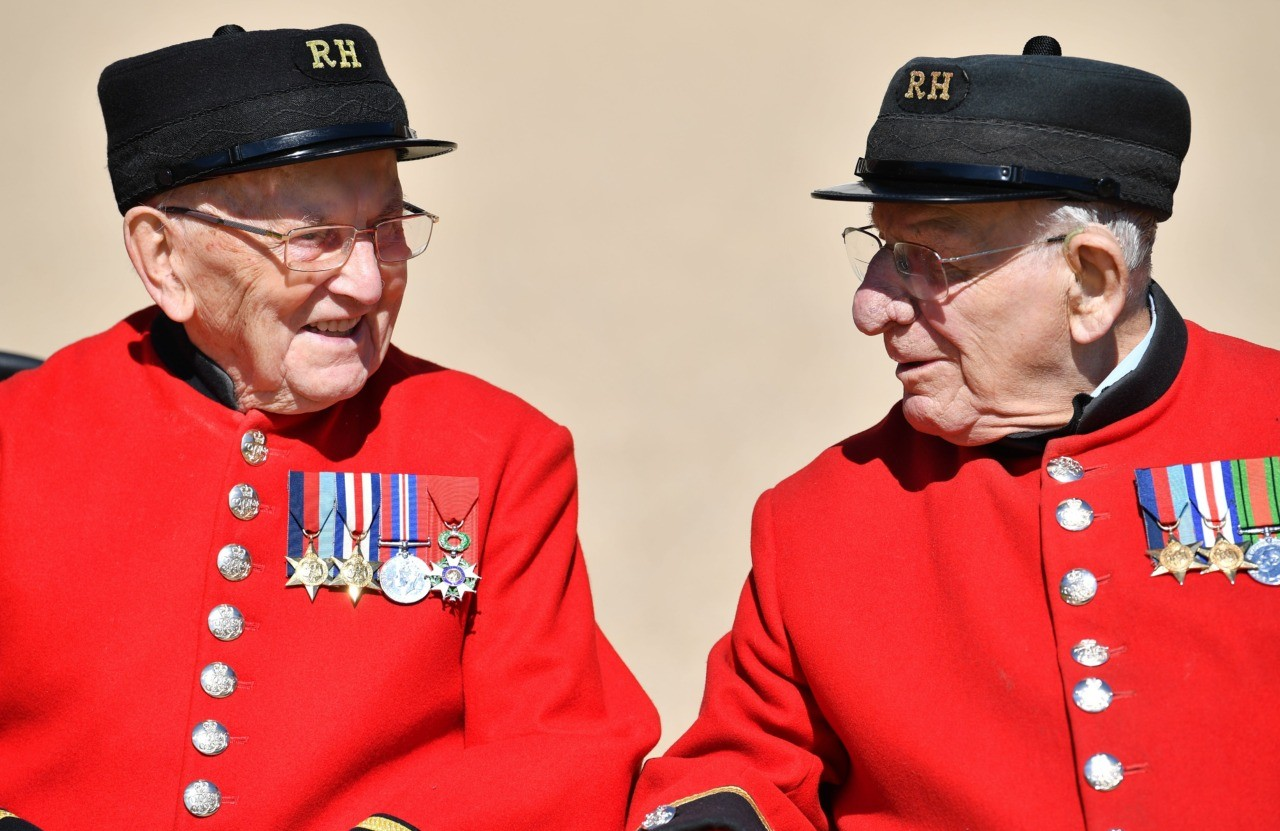 Chelsea Pensioners who is World War Two Battle of Normandy and D-Day veterans Bill Fitzgerald (L) and Fran Mouque (R) pose for a photograph at The Royal Hospital Chelsea in London on May 13, 2019. - 2019 marks the 75th Anniversary of the D-Day landings in Normandy. The Battle of Normandy, codenamed Operation Overlord, saw Allied forces take part in a massive amphibious invasion of occupied France at the Normandy coast creating a beachhead for a ground assault which marked a major turning point in the Second World War. (Photo by Ben STANSALL / AFP) / The erroneous mention[s] appearing in the metadata of this photo by Ben STANSALL has been modified in AFP systems in the following manner: [Fran Mouque] instead of [George Skipper]. Please immediately remove the erroneous mention[s] from all your online services and delete it (them) from your servers. If you have been authorized by AFP to distribute it (them) to third parties, please ensure that the same actions are carried out by them. Failure to promptly comply with these instructions will entail liability on your part for any continued or post notification usage. Therefore we thank you very much for all your attention and prompt action. We are sorry for the inconvenience this notification may cause and remain at your disposal for any further information you may require.        (Photo credit should read BEN STANSALL/AFP/Getty Images)