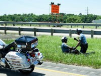 A police officers aids an officer involved in an accident while escorting a motorcade with US President Donald Trump from Chennault International Airport May 14, 2019, in Lake Charles, Louisiana. (Photo by Brendan Smialowski / AFP) (Photo credit should read BRENDAN SMIALOWSKI/AFP/Getty Images)