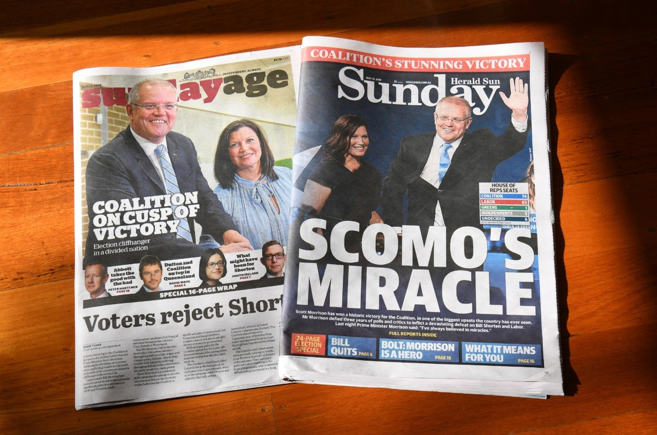 "This photo illustration taken on May 19, 2019 show Sunday newspapers in Melbourne displaying the victory of Australia's coalition government after they clung to power in a general election they were expected to lose. - Australia's ruling conservative coalition defied expectations to retain power in national elections on May 18, prompting Prime Minister Scott Morrison to declare: ""I have always believed in miracles!"" (Photo by William WEST / AFP) (Photo credit should read WILLIAM WEST/AFP/Getty Images)"