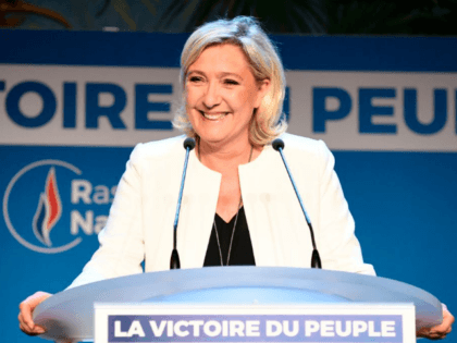 French far-right Rassemblement National (RN) President and member of Parliament Marine Le Pen delivers a speech after the announcement of initial results during an RN election-night event for European parliamentary elections on May 26, 2019, at La Palmeraie venue in Paris. (Photo by Bertrand GUAY / AFP) (Photo credit should …
