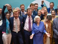 LONDON, ENGLAND - MAY 27: Brexit Party leader Nigel Farage poses with newly elected Brexit Party MEPs, including Annunziata Rees-Mogg, Dr David Bull (L) and Ann Widdecombe (R) at a Brexit Party event on May 27, 2019 in London, England. The Brexit party won 10 of the UK's 11 regions, …
