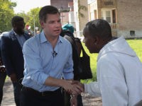 CHICAGO, ILLINOIS - MAY 22: Democratic presidential candidate Congressman Eric Swalwell (D-CA) greets residents during a brief walking tour of the city's southside before meeting with community activists to discuss ways to end gun violence on May 22, 2019 in Chicago, Illinois. Swalwell is one of more than 20 candidates …