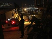 ACAPULCO, MEXICO - MARCH 03: A Mexican army soldier stands guard at a suspected drug-related murder site March 3, 2012 in Acapulco, Mexico. A forensics team excavated five corpses from the floor of an abandoned house. Officials said the five victims were apparently buried alive in concrete. Drug violence has …