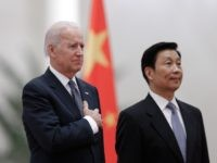 Chinese Vice President Li Yuanchao (R) and US Vice President Joe Biden (L) listen to their national anthems during a welcoming ceremony inside the Great Hall of the People in Beijing on December 4, 2013. Biden arrived in Beijing to raise concerns over a Chinese air zone ramping up regional …