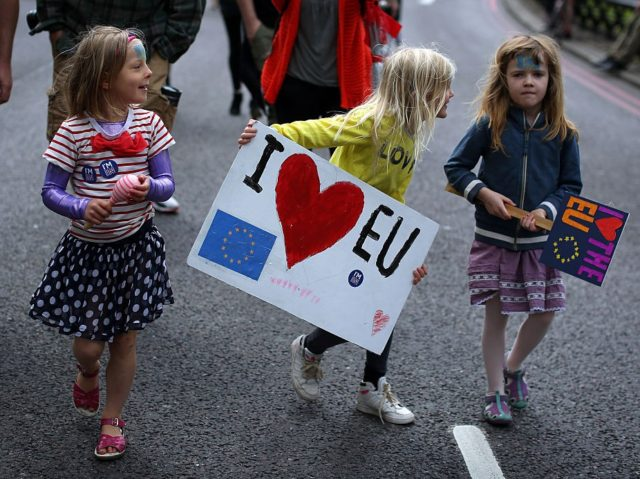 LONDON, ENGLAND - JULY 02: Two young girls hold placards as tens of thousands of people march through central London in a 'March For Europe Event' on July 2, 2016 in London, England. The march is in protest at the result of the EU referendum. (Photo by Dan Kitwood/Getty Images)