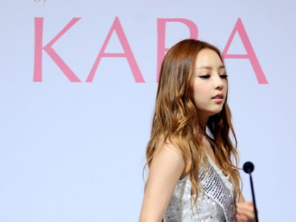 "South Korea's pop girl group KARA's Goo Ha-ra arrives for a press conference in Singapore, Tuesday July 10, 2012. KARA is scheduled to perform their one-night concert here as a campaign to launch their own line of perfume fragrance ""K5J"" or ""K 5 Jewel"". (AP Photo/Wong Maye-E)"