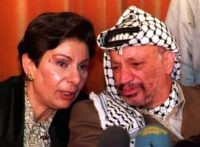 Hanan Ashrawi and Yasser Arafat (Jaques Demarthon / Getty)