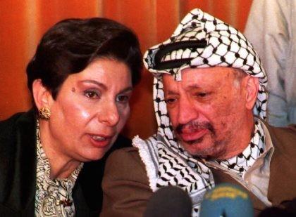 Hanan Ashrawi and Yasser Arafat (Jaques Demarthon / Getty)