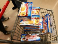 A customer heads to the checkout with a shopping cart loaded with Hostess snacks at a Jewel-Osco grocery store on December 11, 2012 in Chicago, Illinois. The Jewel-Osco grocery store chain purchased the last shipment of 20,000 boxes of Hostess products and put them on sale in their stores throughout …