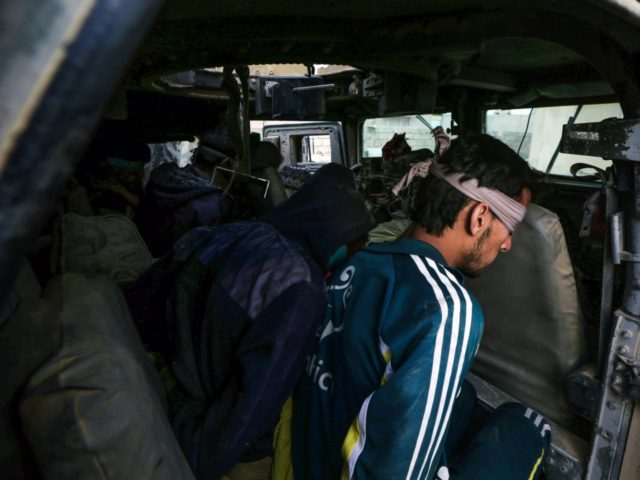 Blindfolded suspected Islamic State group (IS) jihadists sit in a Humvee, after they were captured by Iraqi forces near the ancient town of Nimrud, located 30 kilometres south of Mosul in the Nineveh province, on November 15, 2016. Iraqi forces announced that Nimrud, which was founded in the 13th century …